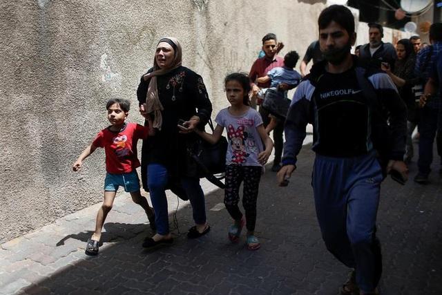 Dải Gaza chìm trong khói lửa, thùng thuốc súng Trung Đông nóng trở lại - 14