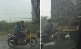 video doi nam nu lieu mang bam duoi xe tai de tranh mua