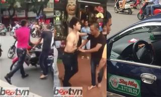 video hai thanh nien manh dong dap vo kinh danh tai xe taxi ngay canh ho guom