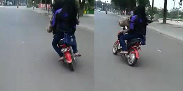 video hai nu sinh di xe dap dien danh vong dieu luyen nhu dan to