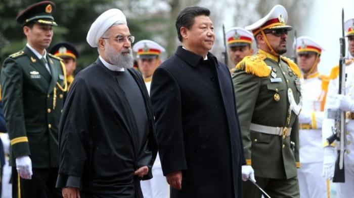 iran vua duoc bo cam van trung quoc tranh thu ket than