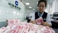 Trung Quốc phá giá đồng tiền, ai bị thiệt?