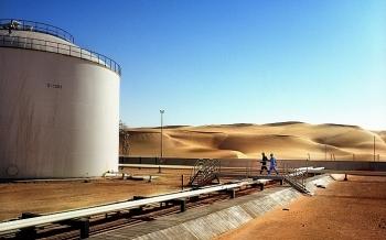 libya chap thuan cho total mua lai co phan cua marathon oil