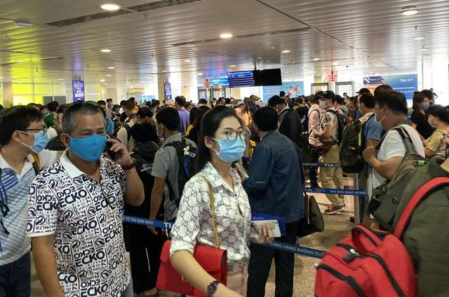 Cao điểm Tết tại Tân Sơn Nhất có 26 chuyến bay cất cánh mỗi giờ - 4