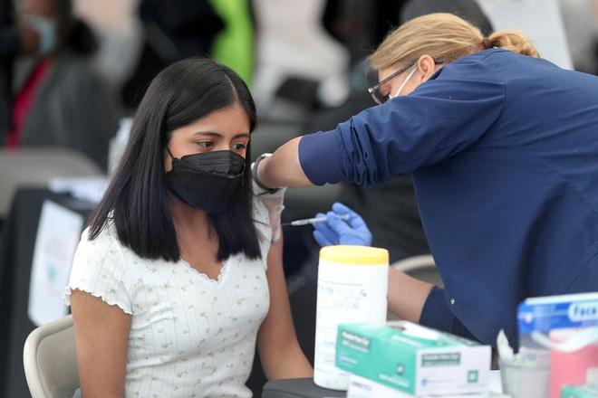 Mỹ công bố hiệu quả đột phá của vắc xin Covid-19 - 1