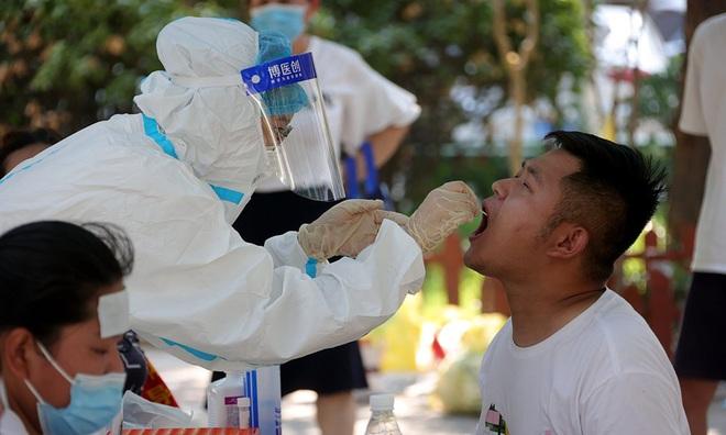Nghiên cứu mới chỉ ra thời điểm virus SARS-CoV-2 lây mạnh nhất - 1
