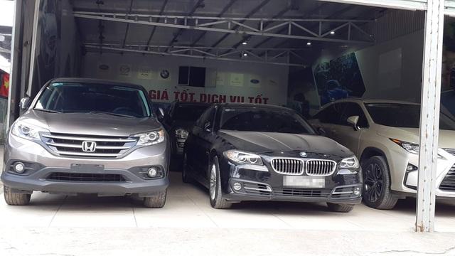 Xe sang giảm giá tỷ đồng, nhiều xế hộp an phận chìm nổi ở Việt Nam - 4
