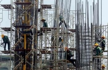 Fitch cảnh báo rủi ro từ chính sách tiền tệ của Việt Nam