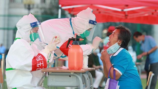 Lo Covid-19 bùng phát, Trung Quốc xét nghiệm 3 triệu dân - 1